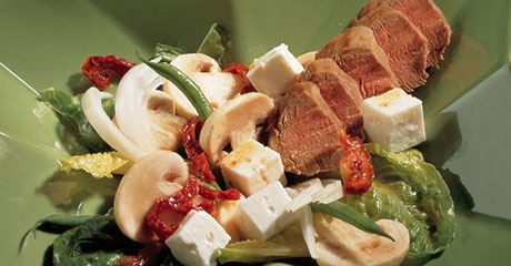 Salade van gemarineerde champignons en witte kaas