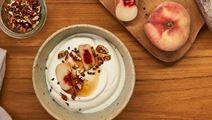 Arla Skyr Creamy with peach, pecan nuts, maple syrup and cardamom