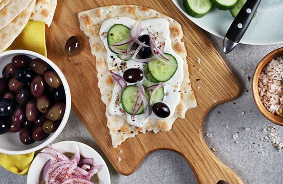 Tameez bread with cream cheese, cucumbers, olives and lime-pickled onions
