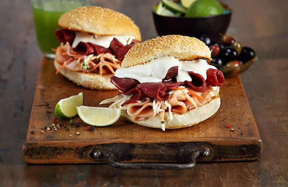 Burgers with cheese, cold cuts meat and coleslaw
