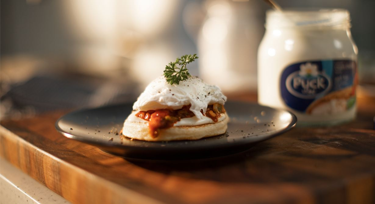 Moroccan Harcha with Poached Eggs, Spicy Tomato Sauce and Cream Cheese Spread