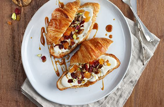 Croissants with cream cheese, dried fruits and nuts
