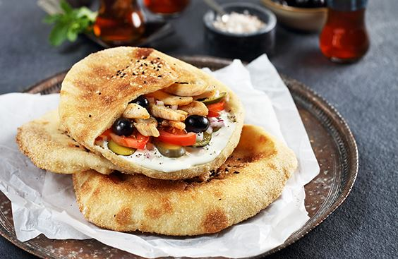 Baladi bread with cream cheese, chicken strips and vegetables