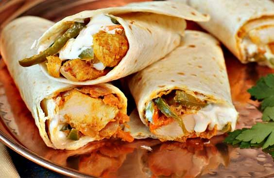 Chapatti bread with cream cheese, chicken strips and vegetables