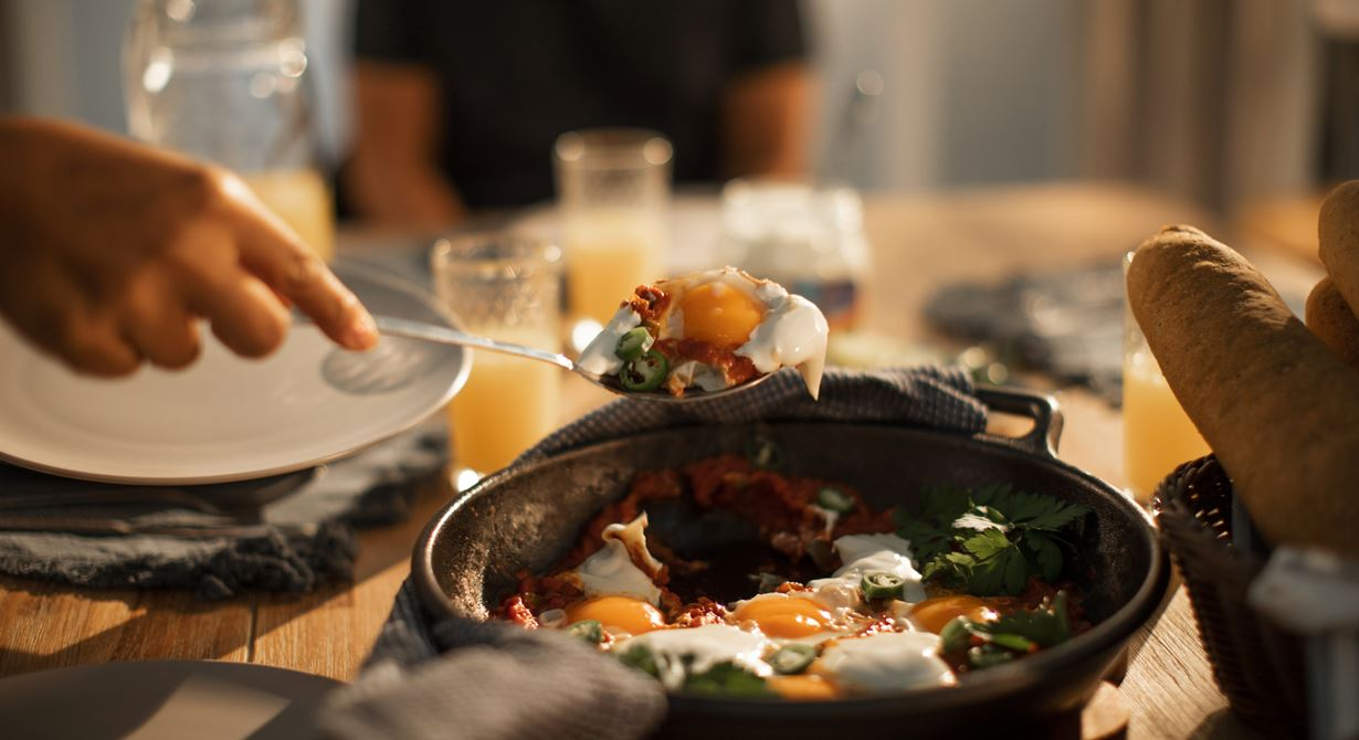 Shakshuka with Cream Cheese Spread and Baguette