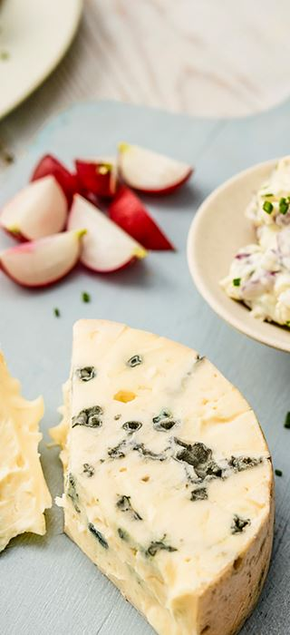 Creamy Blue With Radishes, Chives Served On Crispbread