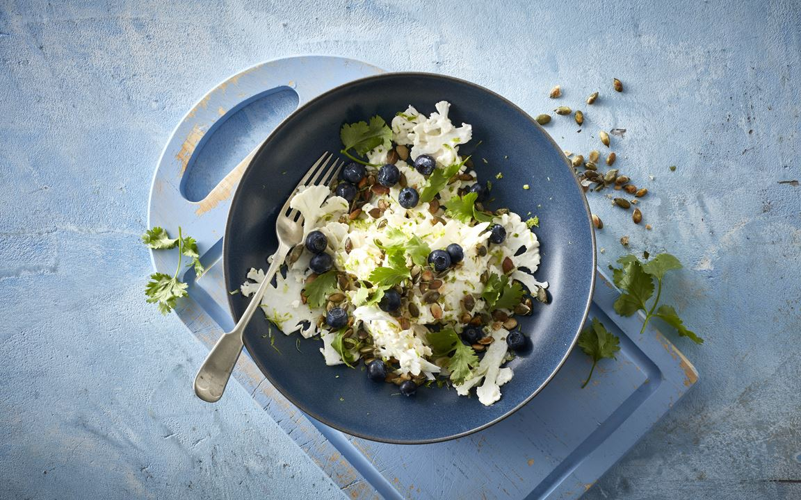 Fresh cauliflower, lime and blueberries
