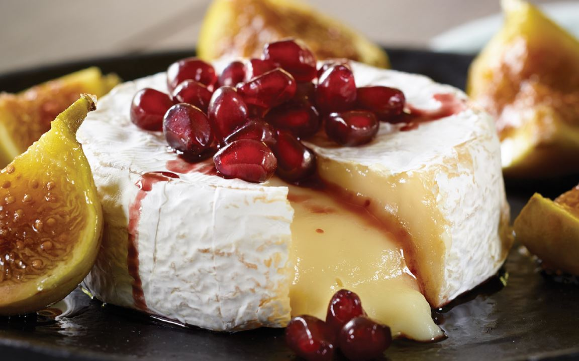 Baked Castello® Brie with Figs and Pomegranate Reduction