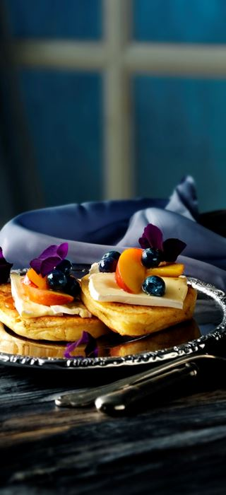 Thick pancakes with blueberry and cheese