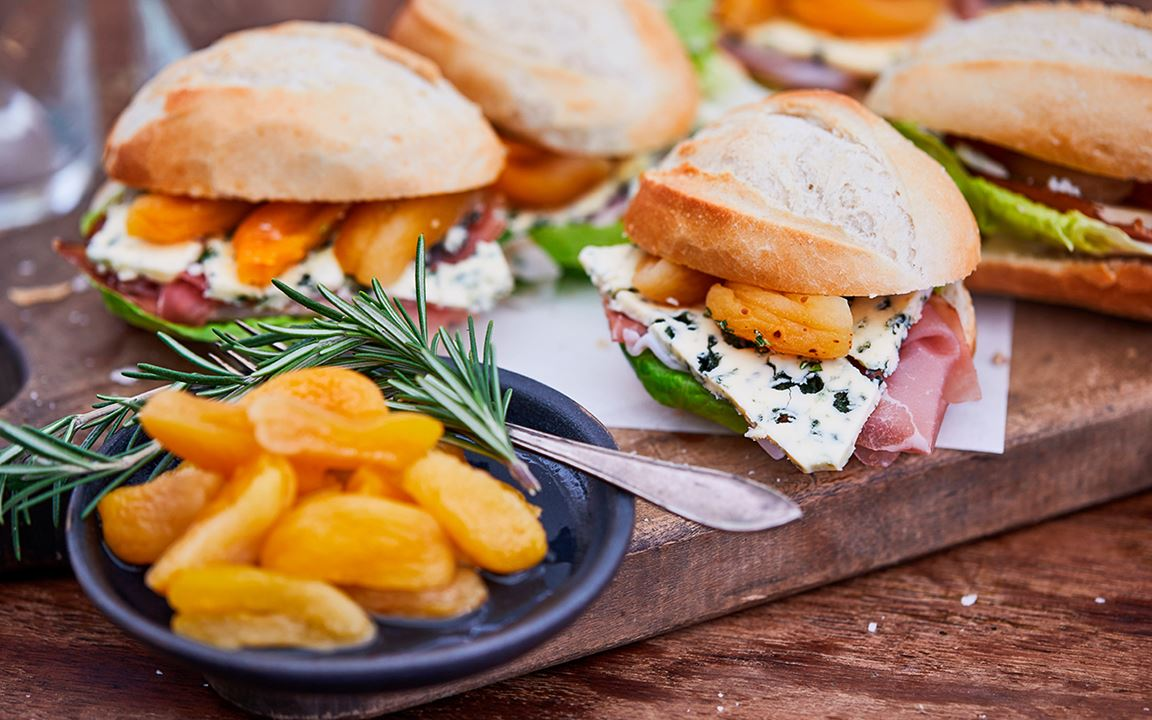 Bocadillos with blue cheese, serrano ham and apricots
