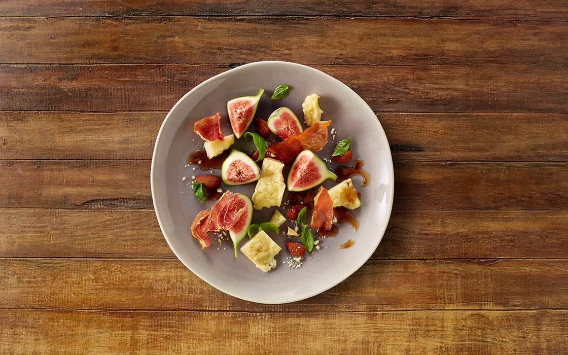 Aged Havarti with crispy parma ham, roasted almonds & figs