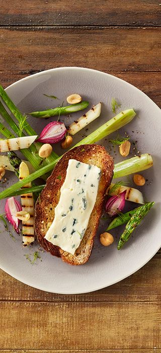 Creamy Blue Cheese with grilled vegetables, peanuts and pickled onions