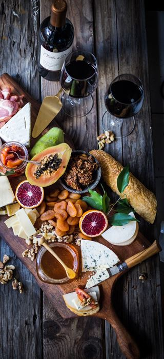Cheese board with blood orange marmelade