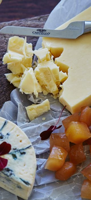 Cheese board with lemon curd and candied ginger