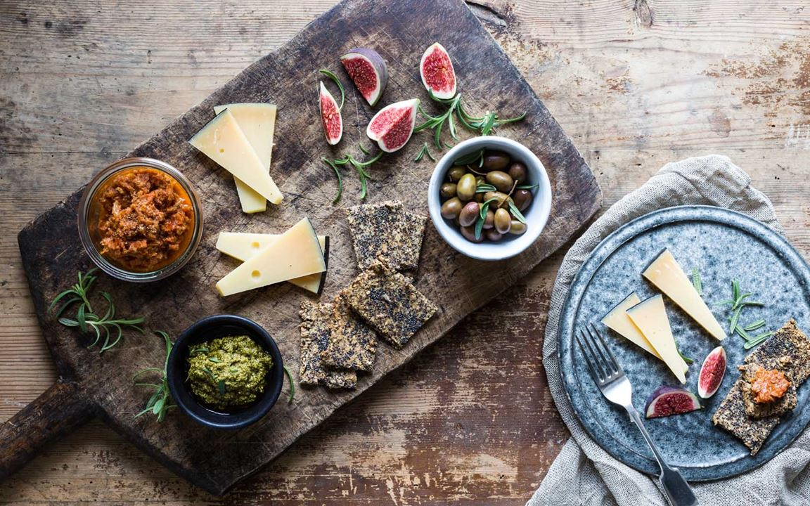 Cheese board with pesto and tomato tapenade