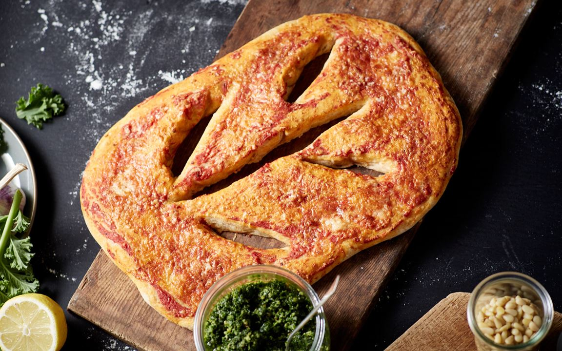 Fougasse with Extra Mature Cheddar, tomatoes and curly kale pesto – the ultimate recipe