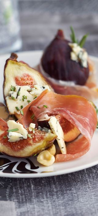 Grilled prosciutto wrapped figs stuffed with Blue Cheese