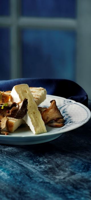 Pickled mushrooms with pink peppercorns and cheese