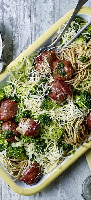 Spaghetti with parsley pesto and meatballs wrapped in prosciutto
