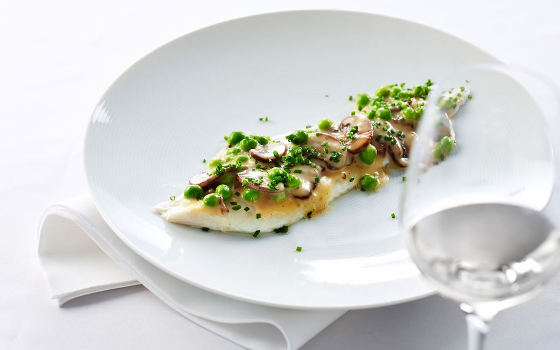 Baked sole with mushrooms & peas