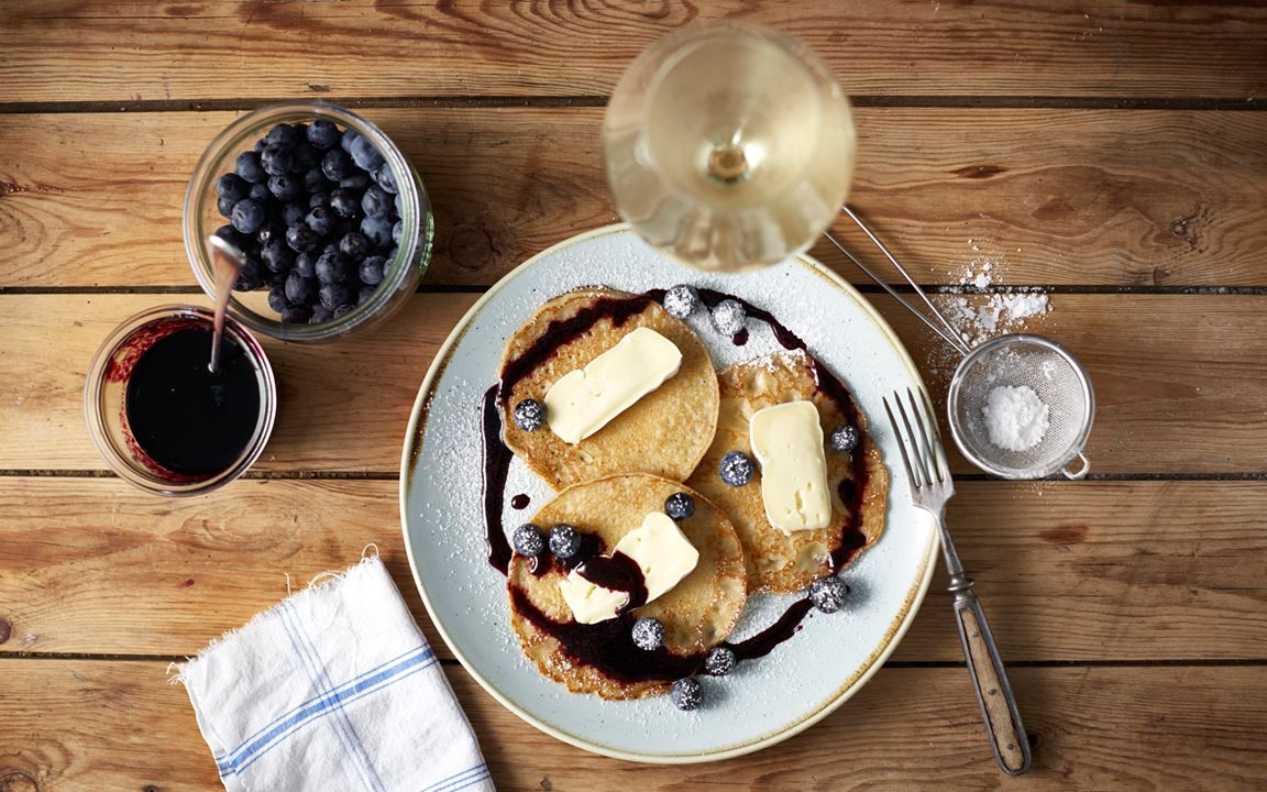 American pancakes with blueberry syrup and Castello Extra Creamy Brie