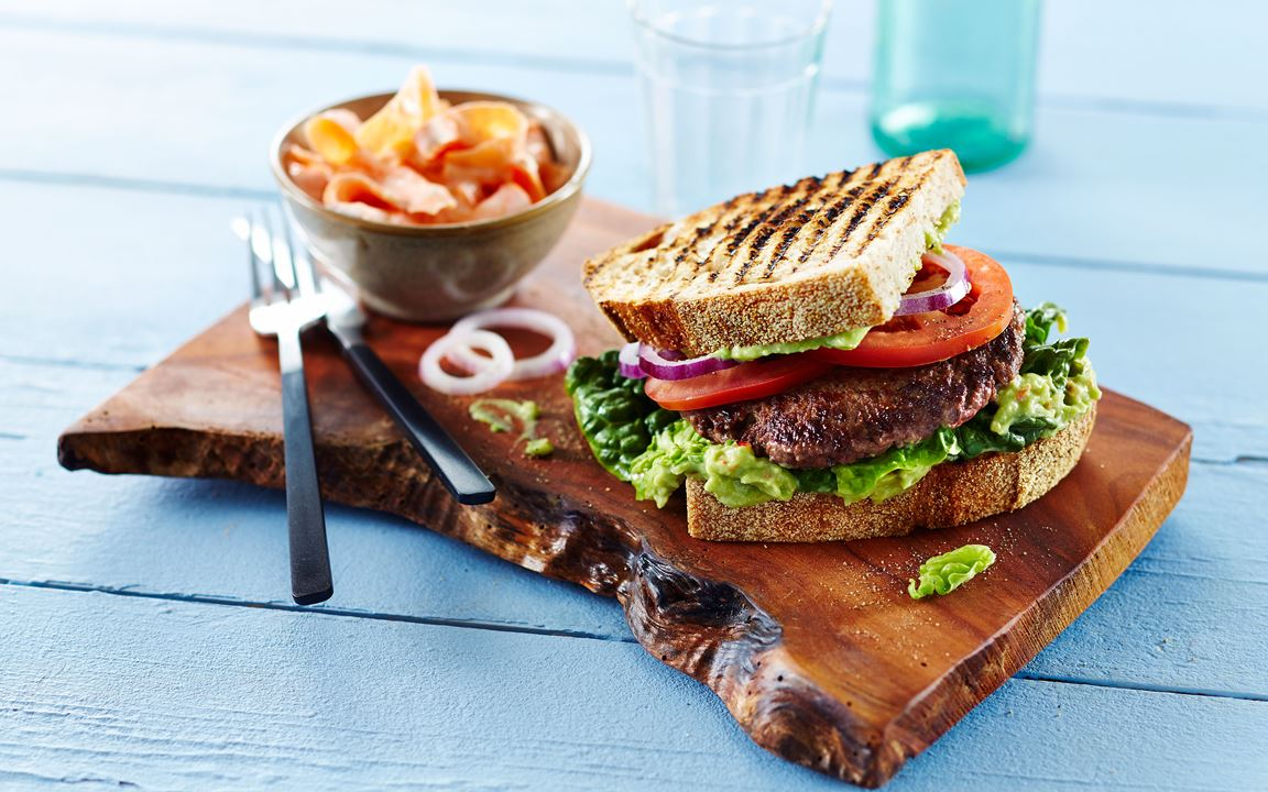 Beef sandwich with avocado cream and carrot salad