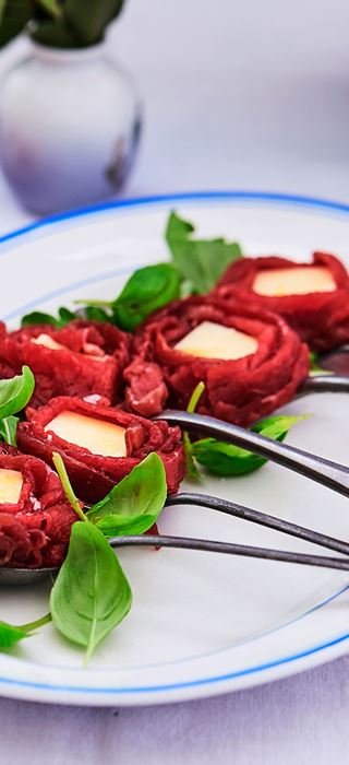 Carpaccio with basil and mature cheddar