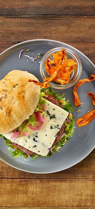 Castello Blue Cheese burger with greens and carrot fries