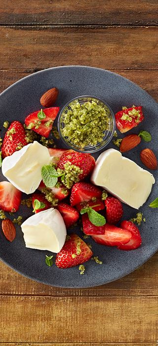 Castello Extra Creamy Brie with strawberries and mint pesto