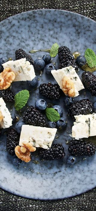 Blue cheese with berries and wet walnuts