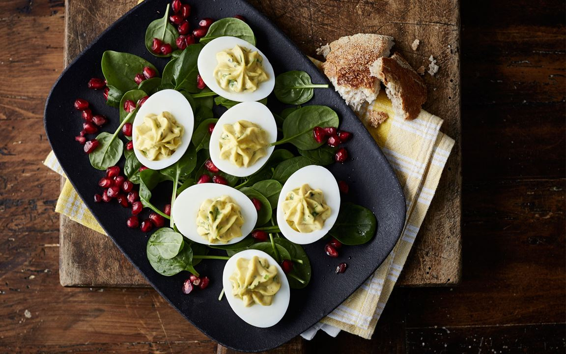 Deviled eggs with Castello Creamy Blue and spinach salad