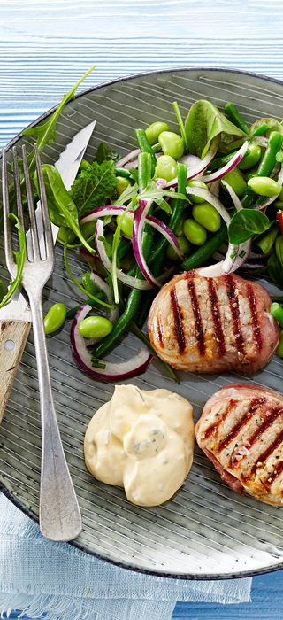 Grilled tenderloin medallions with prosciutto and edamame and bean salad
