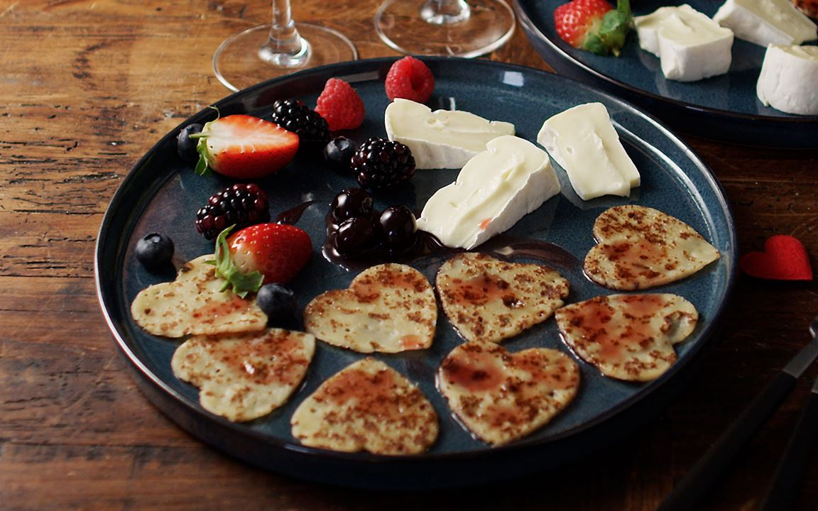 Heart-shaped pancakes with Creamy Brie and berries