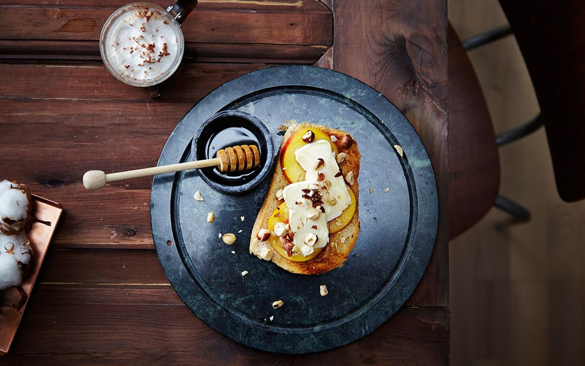 Open breakfast sandwich with Castello Extra Creamy Brie, fresh apricots and hazelnuts