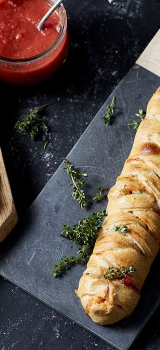 Plaited pizza loaf with Creamy Blue, beetroot, pine nuts and thyme