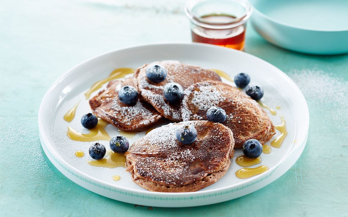 American pancakes with chocolate and blueberries