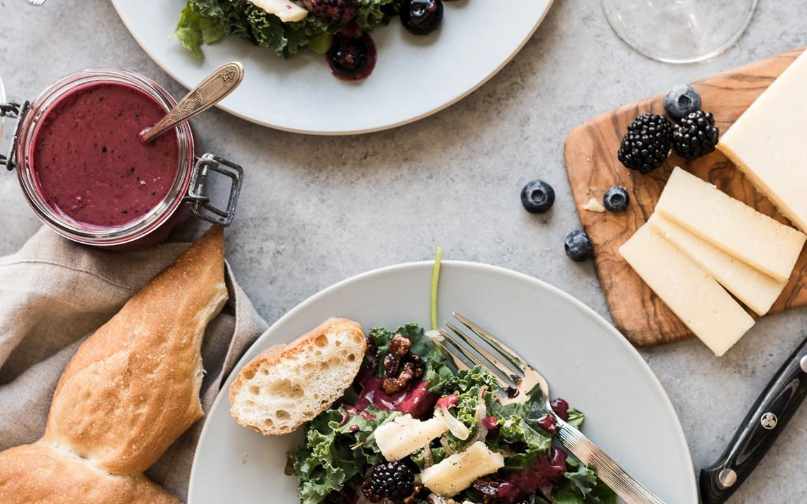 Blackberry and blueberry kale salad with Aged Havarti and berry dressing