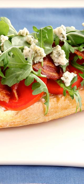 BLT salad on toasted baguette with blue cheese