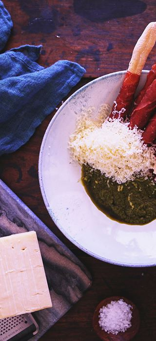 Bresaola wrapped grissini with Cheddar and basil sauce