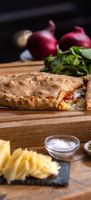 calzone with spinach, sun-dried tomato and onion
