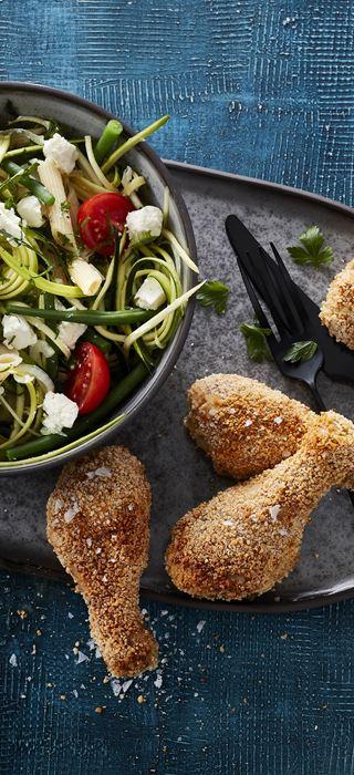 Fried chicken drumsticks with pasta salad