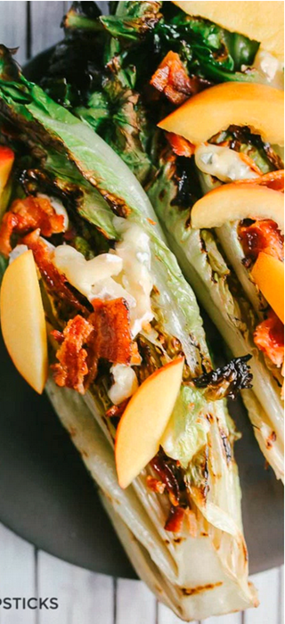 Grilled romaine, peach, bacon and Blue Brie salad