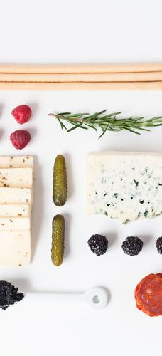 Modern spring cheese board with raspberry spread