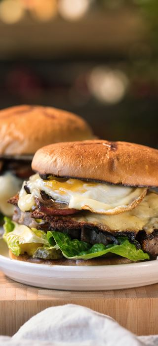 Rib-Eye Burger with fried egg, onions & cheddar
