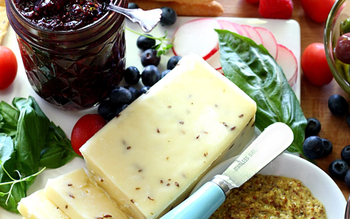 Simple cheese board with double berry chia seed jam