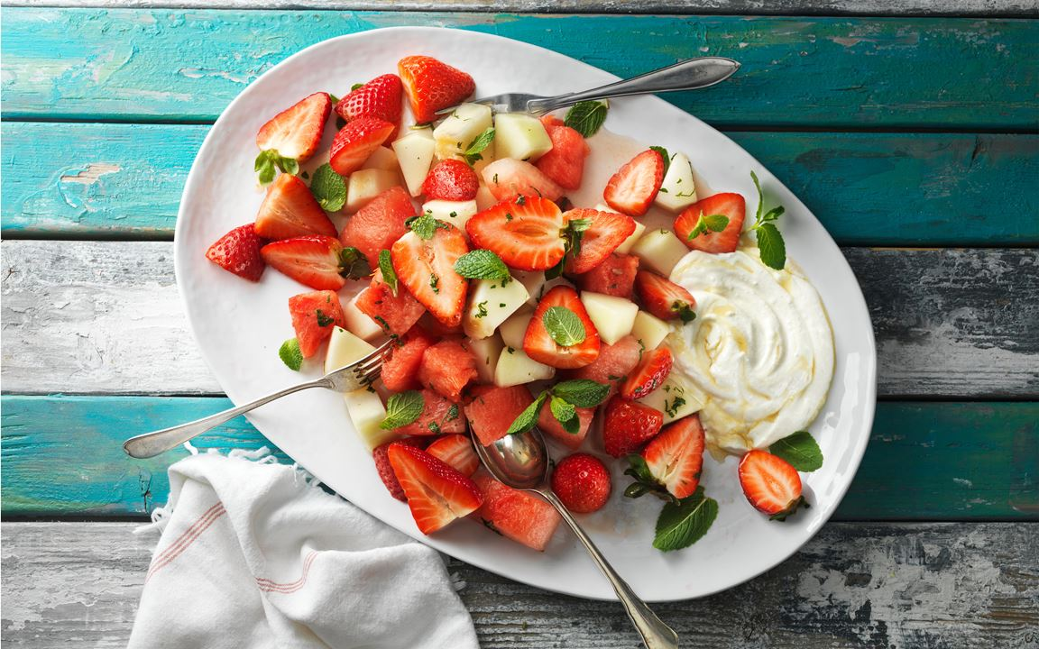 Strawberry salad with melon, lemon and mint