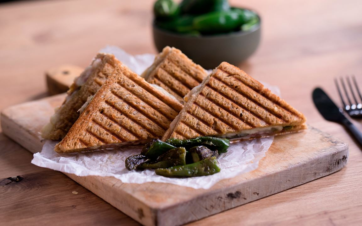 Toasted Serrano ham sandwich with Aged Havarti and Padrón peppers