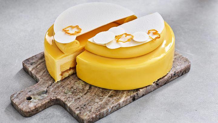 Het tårta på mango, passion och lemon drops